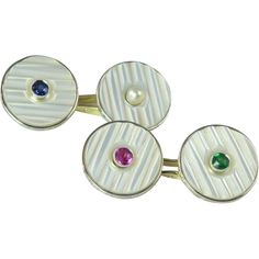 Vintage Art Deco, double-sided cufflinks, comprised of a round, mother-of-pearl disc, with a central gemstone, each one different.