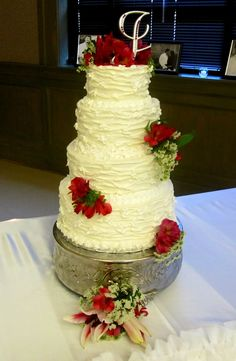 This 4 tiered wedding cake is Italian Cream with Almond Butter cream.