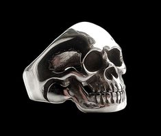 Hey, I found this really awesome Etsy listing at https://www.etsy.com/listing/151749955/sterling-silver-movable-jaw-skull-ring