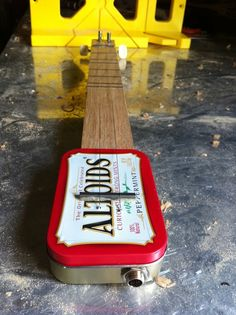 """A fully playable instrument built with an Altoids Tin! Enjoy the """"tinny"""" sound of the instrument acoustically, or plug it into an amplifier to really rock! Matchbox Crafts, Homemade Instruments, Mint Tins, Altered Tins, Altoids Tins, Arts And Crafts, Diy Crafts, Box Guitar, Tin Boxes"""