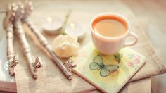 Download wallpaper cup of coffee, cappuccino, book, keys, stand, flower, candle, mood resolution 1366x768