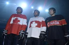Players model the new Canadian 2014 Olympic team hockey jerseys. I must say the ugliest Team Canada  jerseys I ever seen....so disappointed. :>(