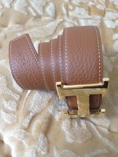 •     Style: Belt •    Brand : Hermes •    Color : Caramel on one and Black on the other side with 3 holes •    Material : Leather •    Buckle :  Smooth Gold buckle   for more information contact me @: siham.payeb@gmail.com