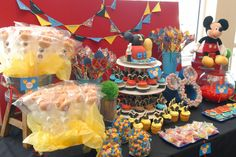 mickey mouse candy table ideas | Cupcake tower cake. The head, foot, and hand was made from rice ...