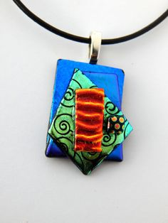 Glass Pendant Colbalt Blue Red Necklace Fused Glass Jewelry Bold Colors Shimmering Dichroic Glass Unique Jewelry OOAK Necklace This listing is for the pendant shown. Each pendant comes with a 16 inch leather cord with a 2 inch chain extender, even if not selected! Each piece of