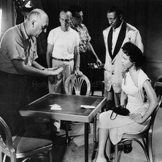 Dorothy Dandridge and Nick Stewart with director Otto Preminger on the set of Carmen Jones, 1954.