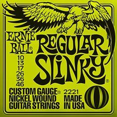 Ernie Ball 2221 Regular Slinky - Jeu de 6 cordes pour guitare électrique. Ces cordes sont utilisées par Eric Clapton, Paul McCartney et John Mayer. Tirants : 010 - 013 - 017 - 026 - 036 - 046
