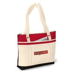 """Need to get somewhere fast this valentines day? This Windjammer Tote has a colorful nautical design with grommet detail, a large main compartment with zippered closure, front packet with velcro closure, and 28"""" shoulder straps."""