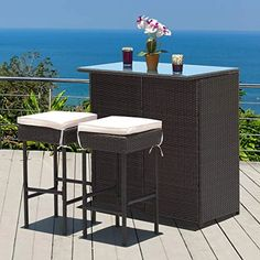 This table has 2 shelves that you can put things underneath the bar so you don't need to fetch over and over again. Made of PE wicker and sturdy frame, the set has a large weight capacity and is weather-proof for long time service. Porch Bar, Patio Bar Set, Bar Stool Cushions, Bar Table And Stools, Outside Bars, 3 Piece Dining Set, Cafetiere, Outdoor Furniture Sets, Outdoor Decor