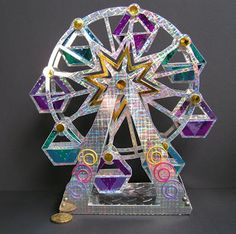 Check out Elke's Ferris Wheel she made using mirror cardboard!  Love the bright shimmer!  From the SUMMER STREET CARNIVAL SVG KIT.