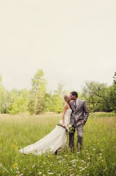 wedding first look mountain field, cheek kiss love, marriage, husband and wife - Jayne B Photography