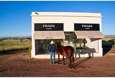 If I were a meandering Cowgirl in Marfa, Texas, this would piss me off.  It's a sealed Prada store sitting freestanding off an open highway filled with Prada's 2005 collection.  Photo being sold on OKL.