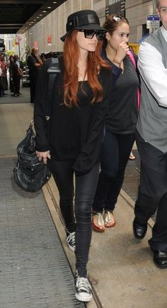 Ashlee Simpson wearing Balenciaga Giant Pompom Bag, Converse All Star Hi Tops in Black and Marc Jacobs 279s Sunglasses in Black.