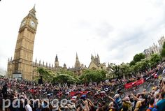 The Peloton passes the Houses of Parliament during Stage three of the Tour de France, London.