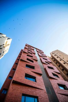 The 'Edges Apartments'; with its articulated brick cladded facade & exposed concrete finish; lights up the streets of the predominantly expat neighborhood of Salmiya, Kuwait. By Studio Toggle Architects Brick Architecture, Residential Architecture, Amazing Architecture, Architecture Details, Brick Design, Facade Design, Exterior Design, Brick Masonry, Brick Facade