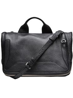 Lark small messenger bag in black from 3.1 Phillip Lim featuring a large flap with zipper design, small shoulder strap, pocket with zipper closure in the back and multiple compartment storage inside. Measures: 19