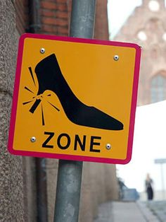 When approaching this cobbled Danish street, high-heeled women are properly warned of the stiletto-breaking terrain ahead. Photo courtesy of Espresso Marco via Flickr.     Read more: Weird Road Signs - See 10 Weird Road Signs From Around the World at WomansDay.com! - Woman's Day