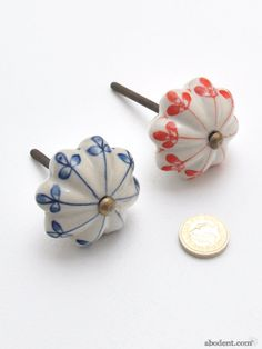 Clover Pinwheel Cupboard Knob, Painted Ceramic Flower Knob, The sprouting design on this tactile knob will bestow a freshness and new lease of life to Cupboard Knobs, Ceramic Flowers, Ceramic Painting, Paint Designs, Pinwheels, Antique Brass, Belly Button Rings, Stud Earrings, Hand Painted