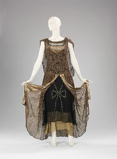 "Evening Dress, Alice Herbin & Company: ca. 1929, French, metal/silk.    By the late 20s the hemline, which had risen to above the knee, began to lower. Often the hem was slightly higher in front and lower in back. Additionally, the waistline began to rise. Like this refined French. Its construction is quite complex. This piece is a wonderful expression of the return to femininity.    Marking: Label: ""Alice Herbin & Co. /10, Rue Royale.Paris"""