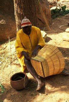 Africa | Basket weaver in Dogon Country, Mali | ©Michel Renaudeau
