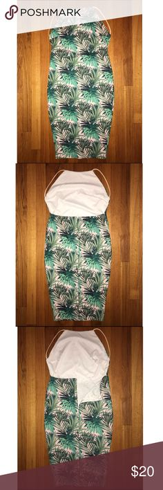 NWOT Boohoo tropical print backless midi dress NWOT Boohoo Night tropical print backless midi dress. Never worn before! Size 8. Fits size 6-8 (stretchy). High neck in the front, backless. Light pink background with green tropical leaves.  Make an offer! No trades. Bundle to save! Boohoo Dresses Midi