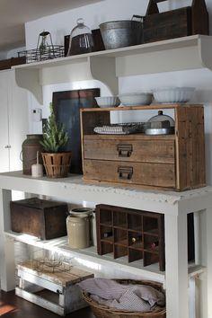 No. 1 details I really love...Primitive, rustic open kitchen storage