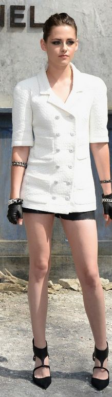 Who made  Kristen Stewart's white short sleeve dress and black cut out shoes that she wore in Paris on July 1, 2013?