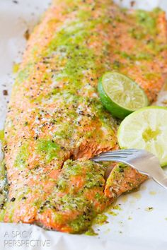Garlic Lime Oven Baked Salmon - A Spicy Perspective-Oven Baked Salmon with garlic, lime and jalapeño makes for a zesty combination that complements the richness of the fish! Our Oven Baked Salmon is moist and Oven Baked Salmon, Baked Salmon Recipes, Fish Recipes, Seafood Recipes, Dinner Recipes, Cooking Recipes, Healthy Recipes, Baked Shrimp, Recipies