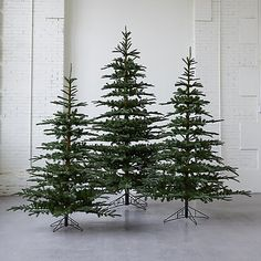Strikingly natural, each of these faux trees is modeled after a singular, unsheared specimen found deep in the woods by an adventurous design team. Farmhouse Christmas Decor, Outdoor Christmas, Christmas Home, Christmas Holidays, Christmas Interiors, Christmas Things, Christmas Morning, Winter Holidays, Christmas 2019