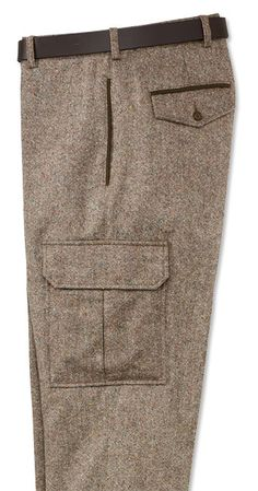 """Comfortable, warm 7-oz. pure Donegal wool. These cargo pants are a vital piece of cool-weather clothing, with large cargo pockets featuring an innovative hidden button closure, dedicated internal cell phone pocket, and D-ring attachment point. Leather trim on every pocket for durability and handsome looks. One button-flap and one button-loop rear pocket. Wool cargo pants in brown. Acetate lining. Dry clean. Imported. <br />Even waist sizes 32-40. Cuffed up to 33"""" or plain finished up to 34""""…"""