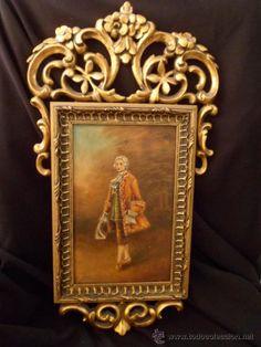 Marco de madera tallada con sobredorados, imagen central de caballero detalles en relieve a mano