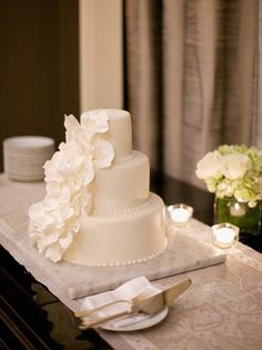 Simple and chic, a white wedding cake at Waldorf Astoria New York.
