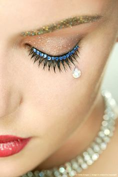 Beautiful sparkly make-up with a glitter brow and aqua crystal lined lashes.