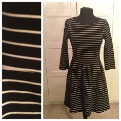 BANANA REPUBLIC b&w striped fit and flare dress EUC!!! Worn just once. This comfortable and flattering dress has a fit and flare cut, with really wide pleats at the waist. This is a cotton dress, but the weight of it feels more like a Ponte fabric. Really great quality! Banana Republic Dresses