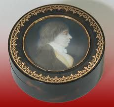 Snuff Box reflected the art and craft of the painter of miniatures, the enameller, the jeweller, and the goldsmith and silversmith. Lids often were decorated with typical 18th-century subject matter such as allegories and flowers. Sometimes they were ornamented with cameos or encrusted with precious jewels in arms and crest. The mull, a silver-mounted ram's head, is a large table snuffbox. Some snuffboxes were worn as articles of jewelry during the 18th century.