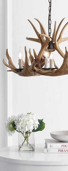 Jonathan Y Antler Chandelier: Constructed from resin, this beautiful chandelier adds a touch of rustic elegance to any space. #rusticlighting #rusticchandeliers #farmhouselighting #farmhousechandeliers #antlerlighting #antlerchandelier #decoratingideas #rustic #farmhouse #chandeliers #loghomes #logcabins Antler Lights, Antler Chandelier, Chandeliers, Modern Rustic Chandelier, Modern Rustic Decor, Farmhouse Lighting, Rustic Lighting, Rustic Farmhouse, Log Home Living