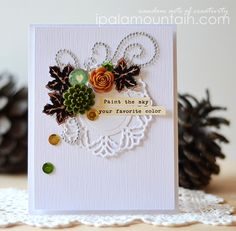 Colage using doily die cut and resin flowers