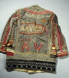 """The """"SAVED"""" jacket, with the words """"Prety K"""" just to the upper left of the word """"SAVED."""" The upper portion of the jacket has the embroidered words """"I never lost the sun… shine an(d) roses."""""""