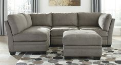 """5 pc Lago collection cobblestone colored fabric upholstered modular sectional sofa set. This set includes the 2 - corner wedges , 2 - armless chairs and 1 - ottoman. Corner wedge measures 39"""" x 39"""" x 37"""" H. Armless chair measures 32"""" W x 39"""" x 37"""" H. Ottoman measures 32"""" x 32"""" x 19"""" H. Additional pieces also available separately at additional cost. Some assembly required."""