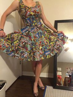 Classic Comic Book Covers featuring Wolverine, Captain America, Thor, The Hulk, and Ironman cover this classy vintage style dress.    Very