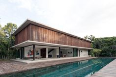 Architectkidd have designed a house for a Swiss family living in Bang Saray, Thailand. The architect's description Located near the east coast of the Gulf of Thai House, Architecture Renovation, Architecture Design, Bauhaus, Casas Containers, House On Stilts, Steel Columns, Building A New Home, Tropical Houses