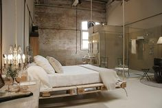 Loft bedroom. Looks like the bed frame is made from pallets and suspended from the ceiling. Wow. Exposed Brick Walls-28-1 Kindesign