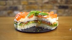 Sushi has come out of nowhere to cement itself as one of the world's favourite foods. Boasting the desirable combination of being trendy and tasty, it seems that the (sort-of) healthy foodstuff is here to stay. Being the food connoisseurs that we are, we began to think about how we could create the sushi dish to end all sushi dishes; that's when we thought-up the Sushi Cake. What you'll need: 500g salmon, skinless and boneless 500g sushi rice (cooked and cooled), seasoned with rice wine…