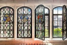 You can open these stunning stained glass windows to look out over all the land that you'll swear never to sell up piecemeal and thus ruin the estate Gramercy Park.  #refinery29 http://www.refinery29.com/2016/07/115709/downton-abbey-castle-apartment-nyc-for-sale#slide-5