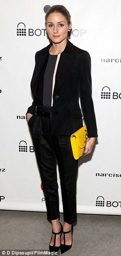 Chic: Socialite Olivia Palermo sadly skipped her most attractive accessory - fiancé Johannes Huebl - in favour of a bright yellow clutch