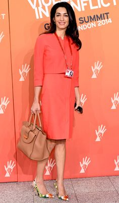 Red-Orange Chic from Amal Alamuddin's Street Style  The human rights lawyer whips out a red ensemble with yet another pair of quirky floral-print shoes at the Global Summit to End Sexual Violence in London.