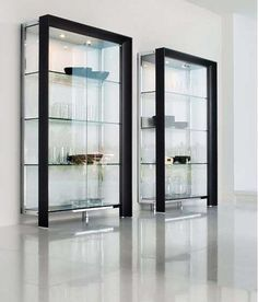 Made almost entirely of glass, this cabinets are a a piece of decor by themselves. ♥ Discover the hottest designs and inspirations on Buffets and Cabinets | Visit us at http://www.buffetsandcabinets.com/ | #buffetsandcabinets #designnews #designinspiration #celebratedesign #interiordesign #designlovers #designbook #furnituredesign #luxuxryfurniture #interiordesigninspiration