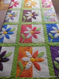Gorgeous applique flower quilt with beautiful quilting to make this a work of art both front and back.