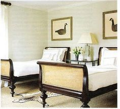 Lovely British Colonial sleigh beds. The rest of the room is a little plain. Elle Decor