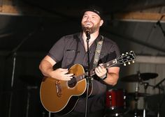 Country music singer-songwriter James Otto sings one of this ballads alone on the Tuscarawas County Fair stage Wednesday night. www.timesreporter.com